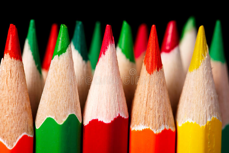 Colered crayon , pencil macro shoot against a dark background stock photos