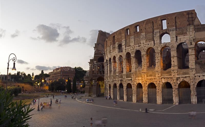 Coleseum in the evening, Rome, Italy. Evening in July 2012 in Coleseum, Rome. People in the foreground appear blurred due to movement. Image is large measuring royalty free stock image