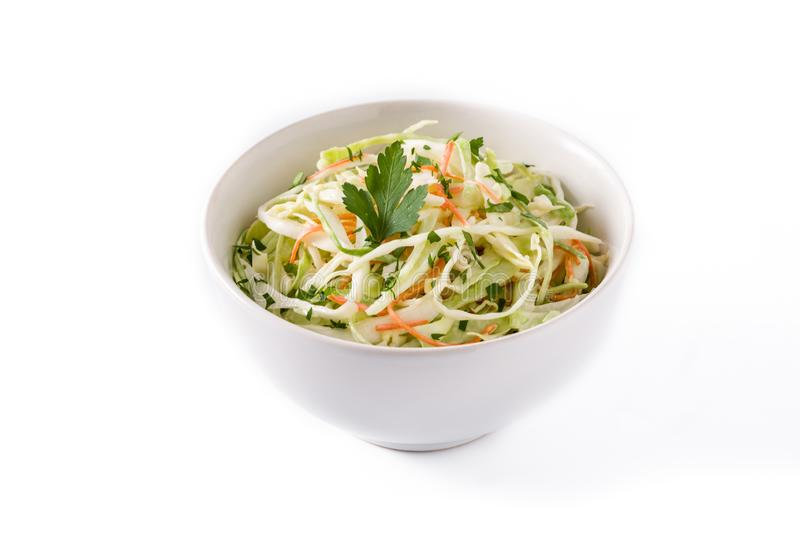 Coleslaw salad in white bowl isolated. On white background royalty free stock image