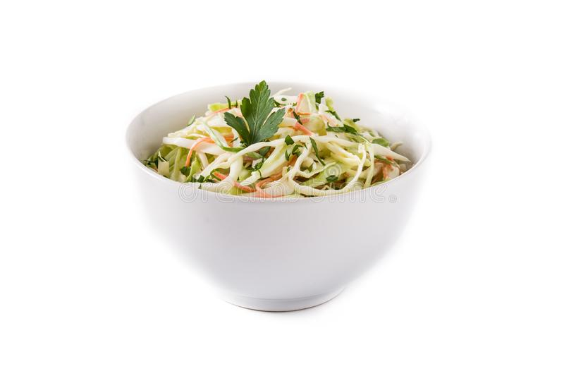 Coleslaw salad in white bowl isolated. On white background stock photography