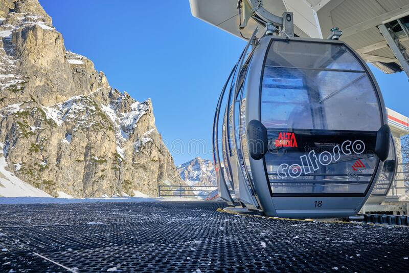 Ski gondola upper station at Colfosco, Alta Badia, part of Dolomiti Superski domain in Italy, with doors opened. Colfosco, Italy - January 24, 2020: Ski gondola stock images