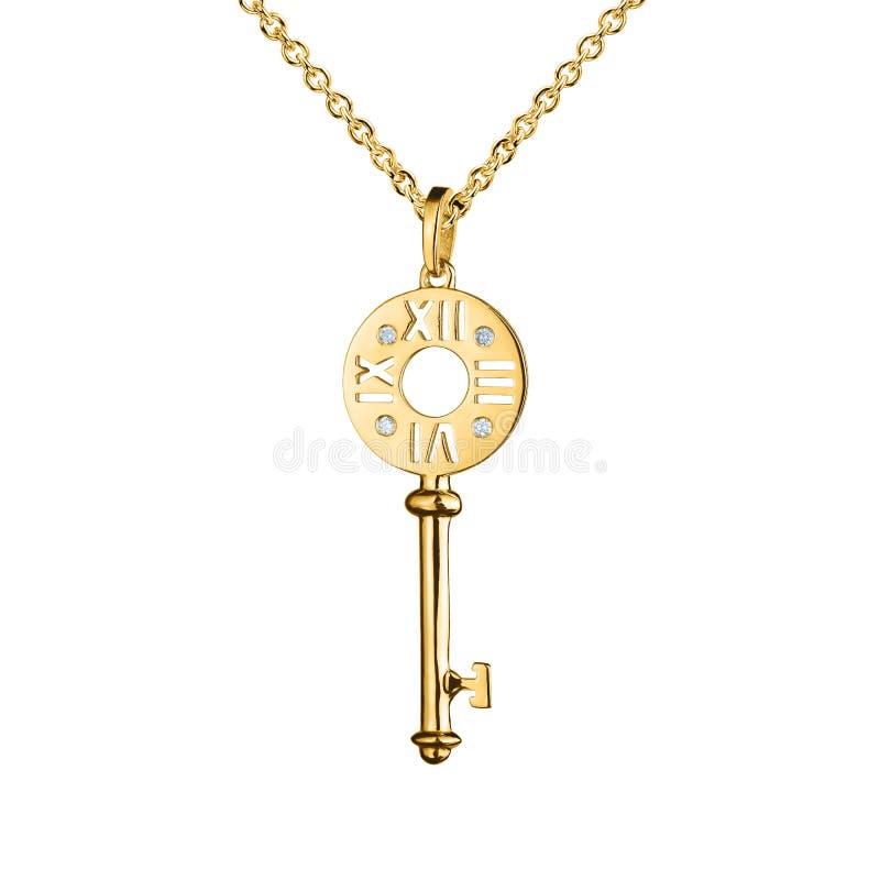 Colgante de oro con los diamantes, llave con las marcas del reloj, cadena de oro, oro amarillo de la joyería, aislado en blanco fotografía de archivo