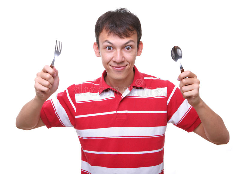 Colher com fome isolada da forquilha do estudante do homem novo fotografia de stock royalty free