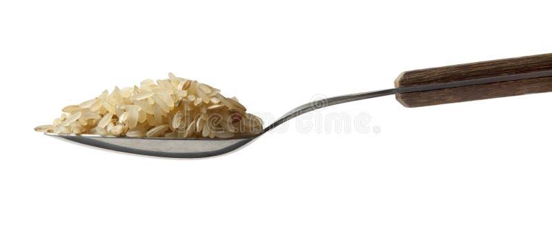 Colher completamente do arroz imagens de stock royalty free