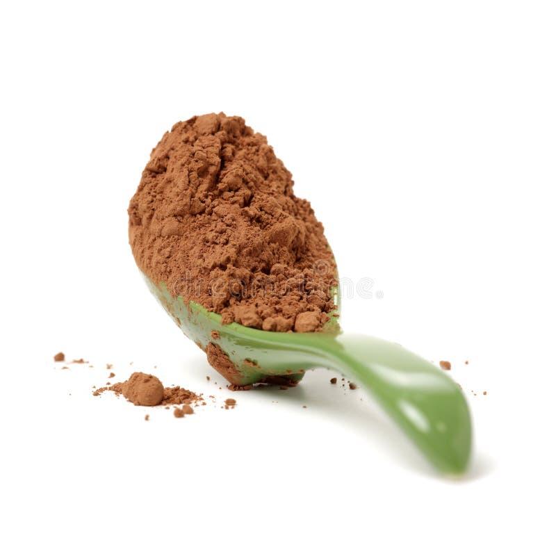 Colher da cerâmica do açúcar mascavado fotografia de stock royalty free