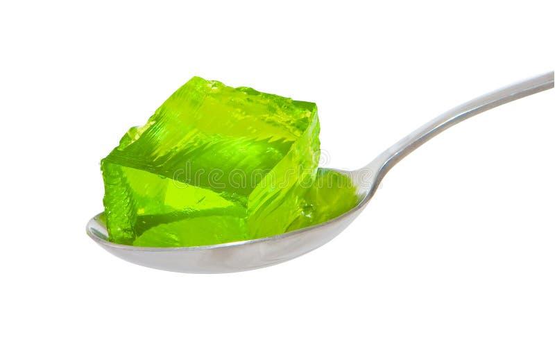 Colher da geléia verde fotos de stock royalty free