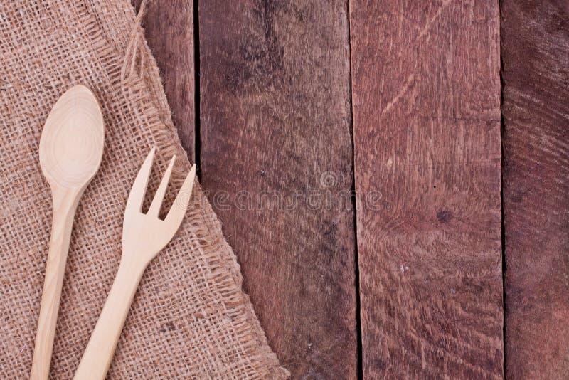 Colher e forquilha de madeira imagens de stock royalty free