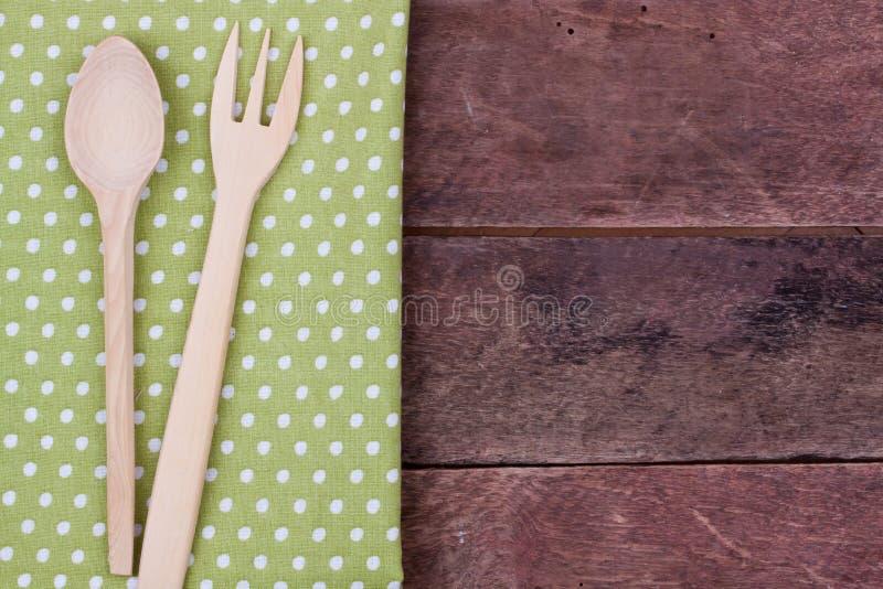 Colher e forquilha de madeira imagens de stock