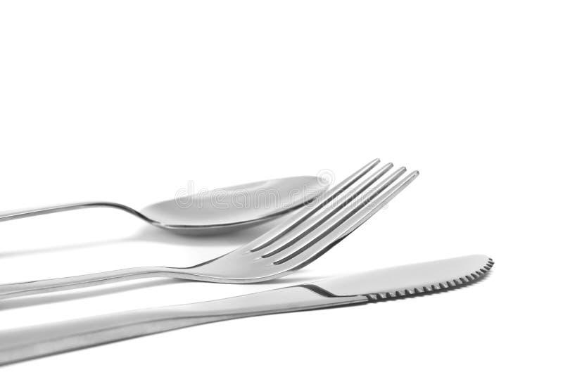 Colher, faca e forquilha. flatware no branco imagem de stock royalty free