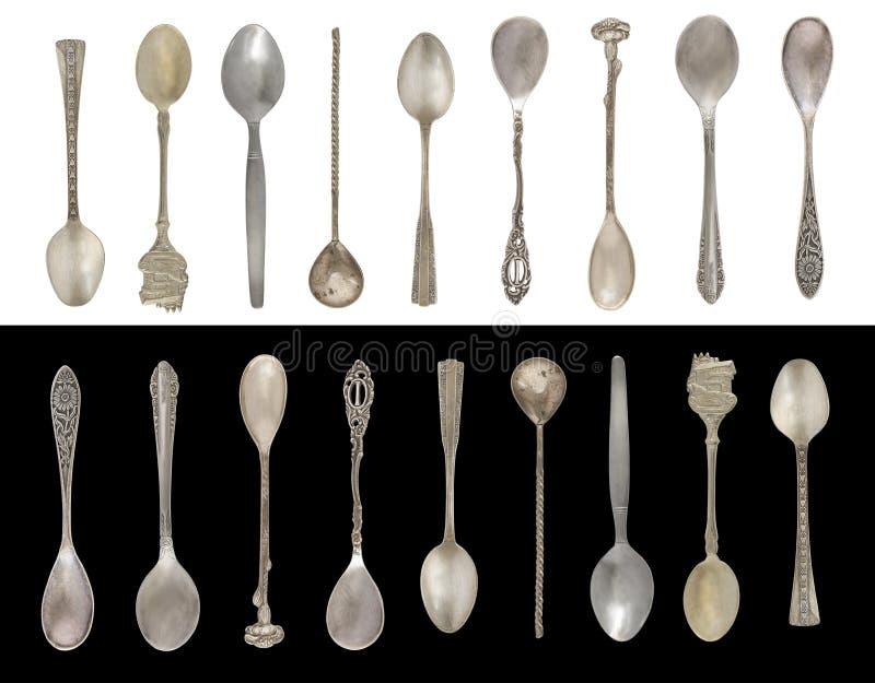 9 colheres do chá do vintage isoladas em um fundo preto e branco Estilo rústico silverware fotografia de stock