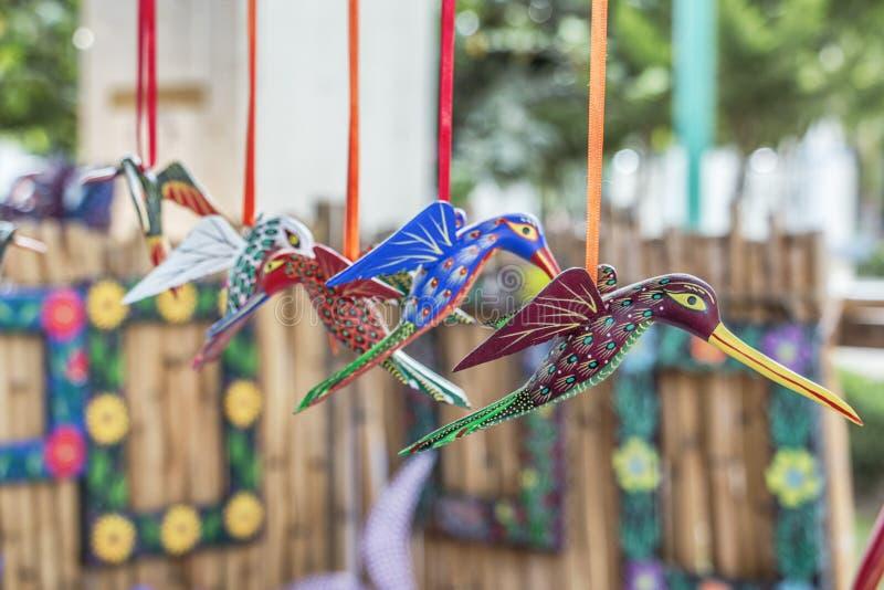 Colibrí Alebrije. Hummingbirds colibrí made with wood in diferent imaginary colours know as alebrije figures. Made in San Martín Tilcajete, Oaxaca stock image