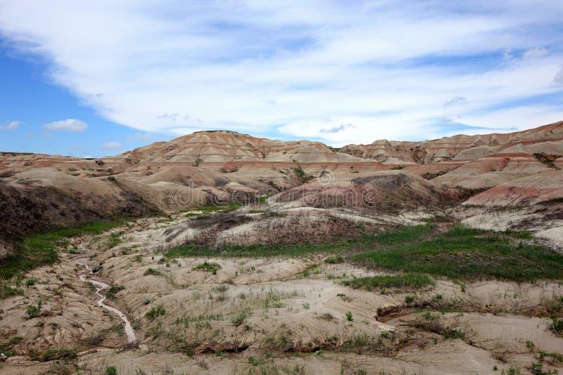 Colinas rayadas rojas, Badlands parque nacional, Dakota del Sur imagenes de archivo