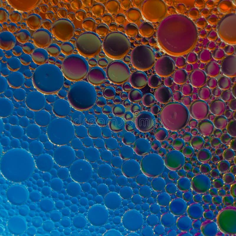 Colisiones del planeta imposibles usando emulsiones del agua del aceite fotos de archivo