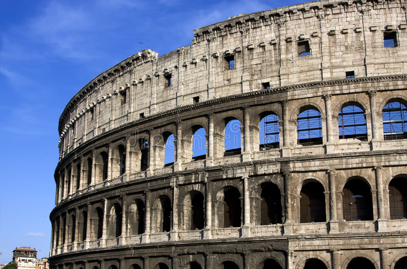 Colisseum. Antique colisseum in Rome over blue sky royalty free stock photography