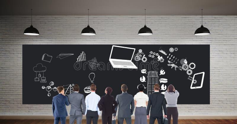 Collègues regardant le panneau d'affichage avec des icônes d'affaires image stock