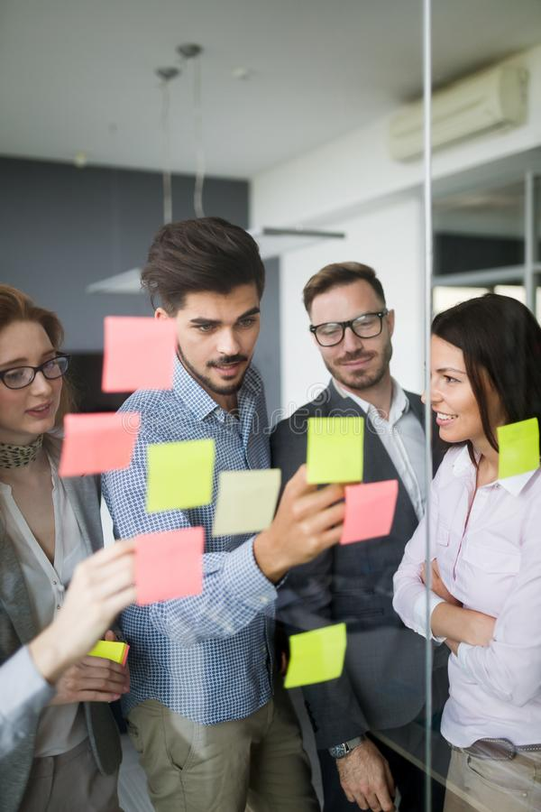Collaboration and analysis by business people working in office stock photos