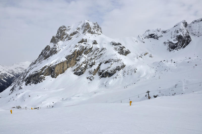Collac slopes in winter, dolomites. Scenic landscape of peak slopes in winter under high snow, shot in cloudy bright light stock photography