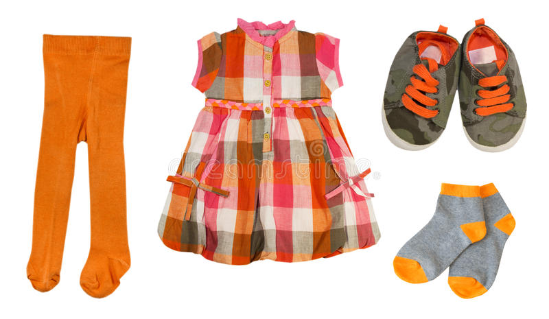 Collage baby clothes set.Isolated. Orange baby clothes set.Collage of girl child clothing.Isolated stock images