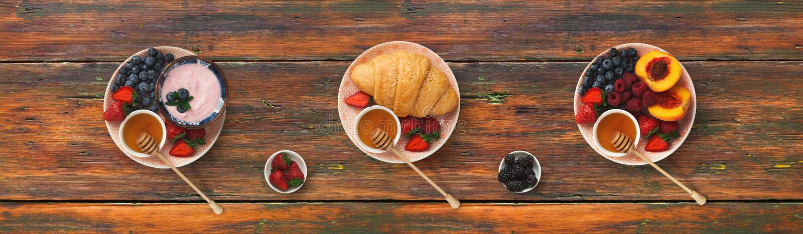 Collage of breakfast meals on wooden background, top view. Set of three breakfast dishes on wooden background. Top view on platters with yogurt, berries, ts and stock image