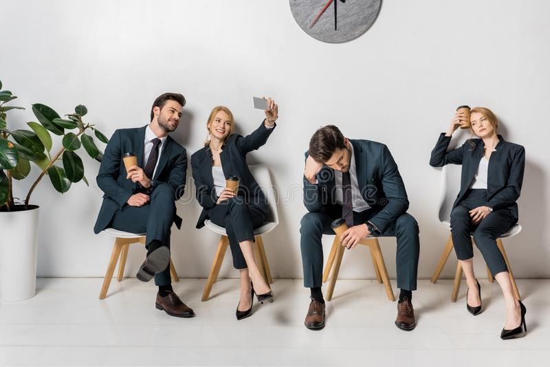 Collage of business people with various emotions and poses waiting on chairs. In line stock photos