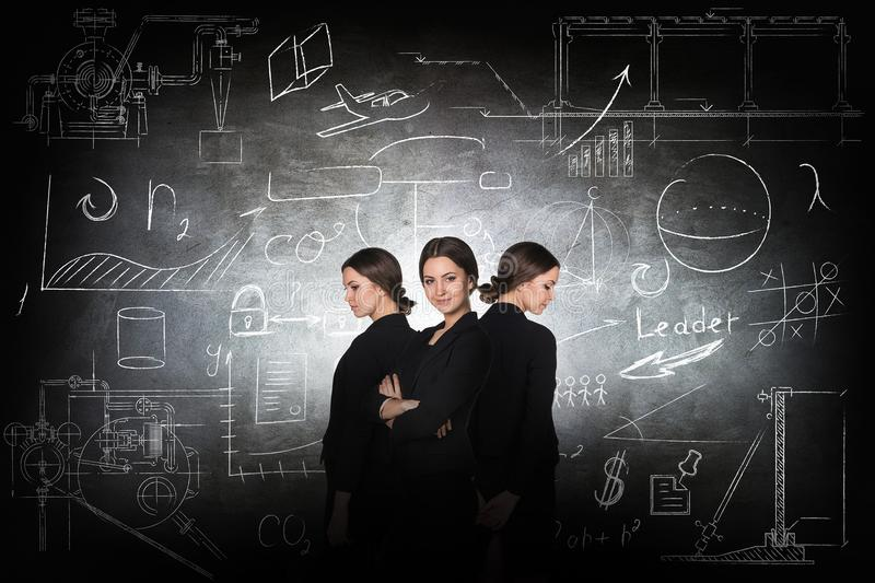 Businesswoman over school chalk board background stock photo