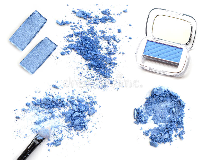 Collage of compositions of compact and crushed multicolor eyeshadow isolated on white. royalty free stock photography