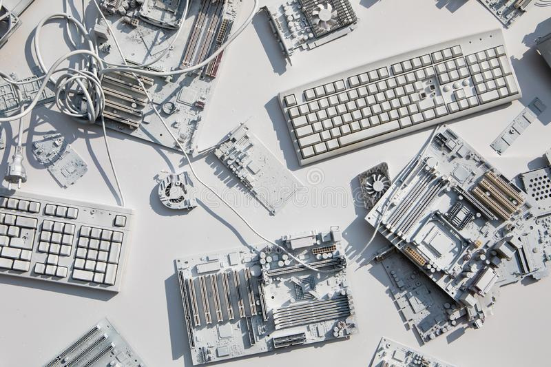 Collage of computer components. A collage of old computer components in white color stock photography
