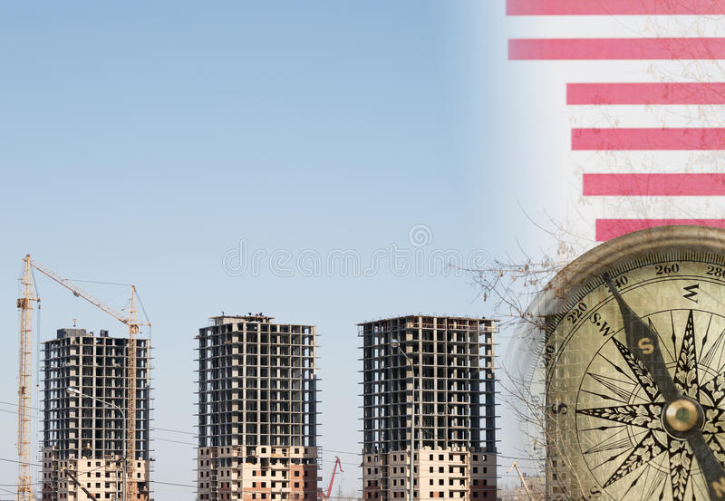 Collage with construction site, cranes and a compass. On graphs royalty free stock photography