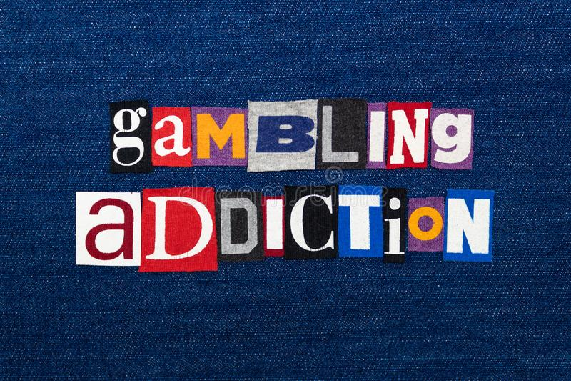 Collage de JEU des textes de mot de DÉPENDANCE, tissu coloré multi sur le denim bleu, concept de jeu de dépendance de recommander images stock
