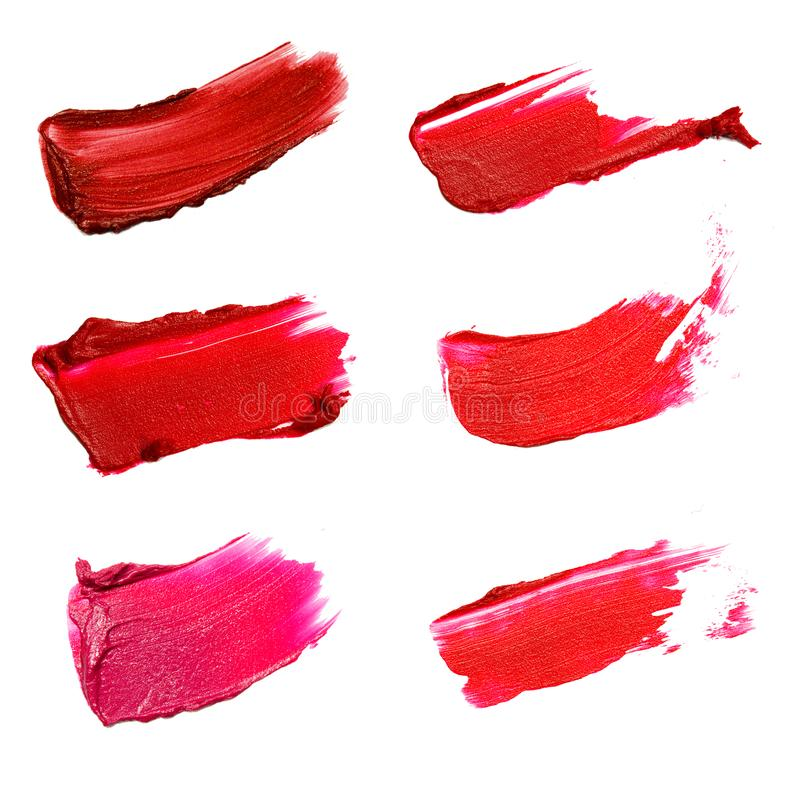 Collage de los movimientos decorativos del lápiz labial del cepillo del color de los cosméticos encendido foto de archivo libre de regalías