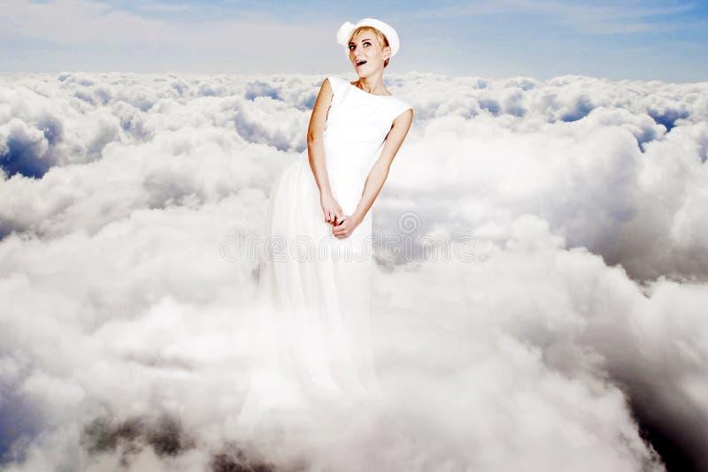 Collage del arte. mujer joven de la belleza en el cielo fotos de archivo