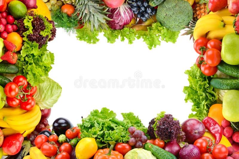 Collage della frutta e delle verdure come struttura isolata su bianco fotografia stock