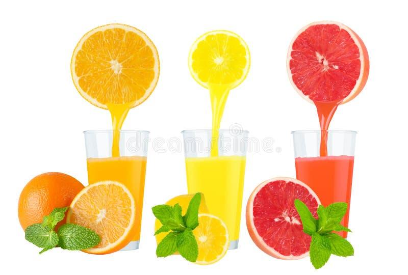 Collage des jus de fruit frais sur le fond blanc photo stock