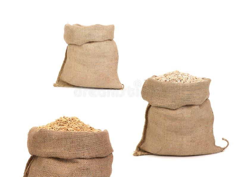 Collage des sacs avec le grain. photo stock