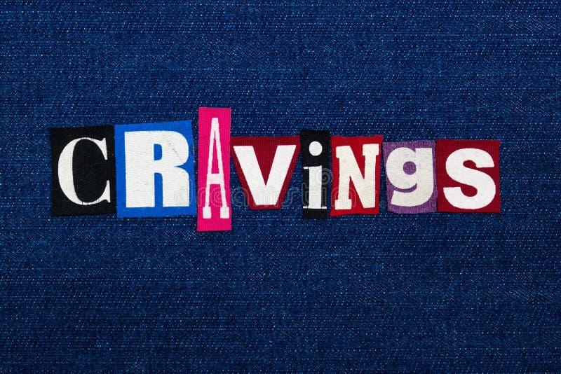 Collage des textes de mot de CRAVINGS, tissu coloré multi sur le denim bleu, concept incontrôlable de recommander image stock