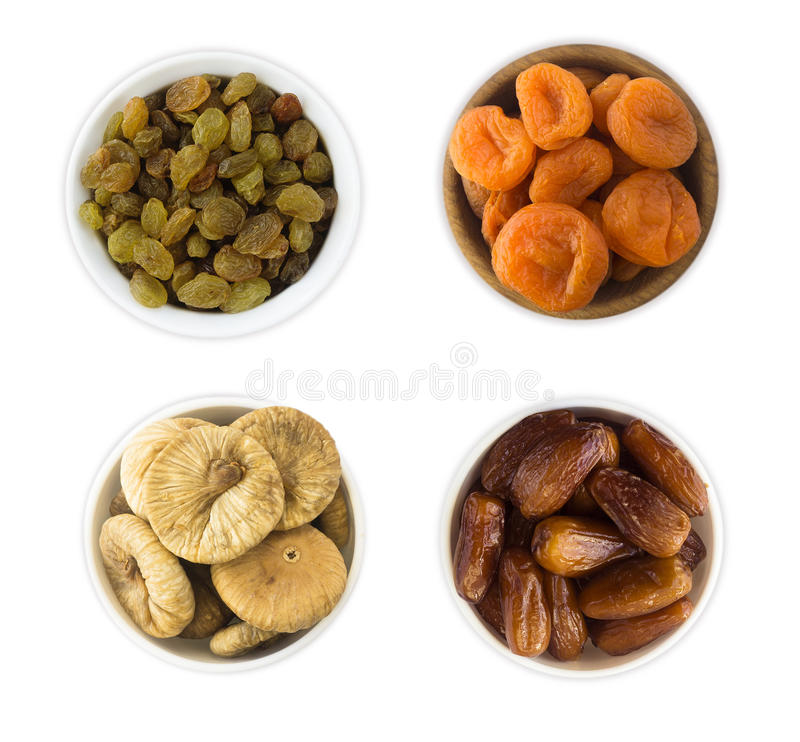 Collage of different dried fruits. Raisins, dates, dried apricots, fig isolated on white background stock image