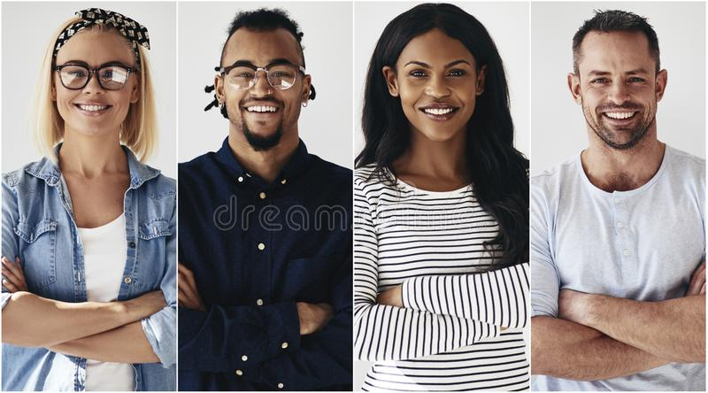 Confident group of diverse young entrepreneurs smiling stock photography