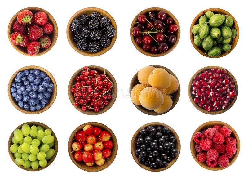 Collage of fruits and berries isolated on a white background. Top view. stock photos