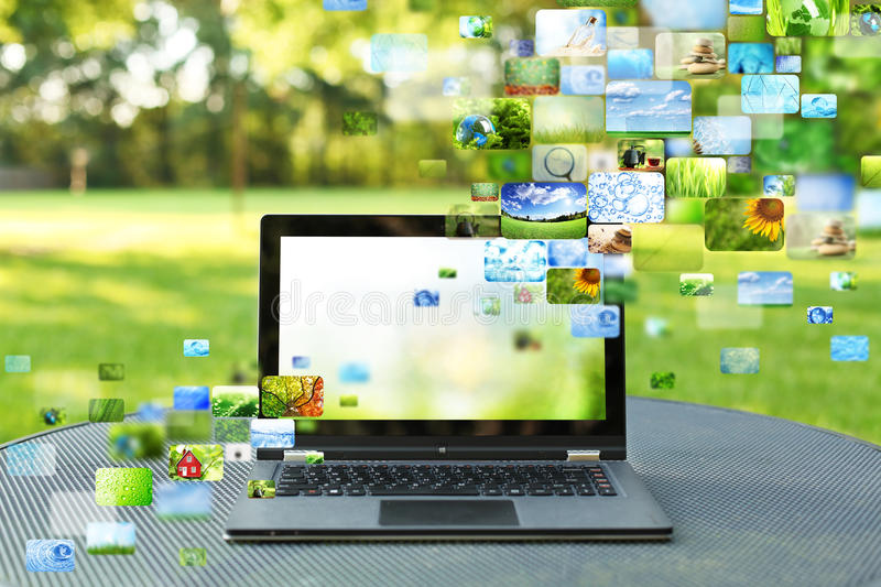 Collage of images. Coming out of a laptop royalty free stock photos