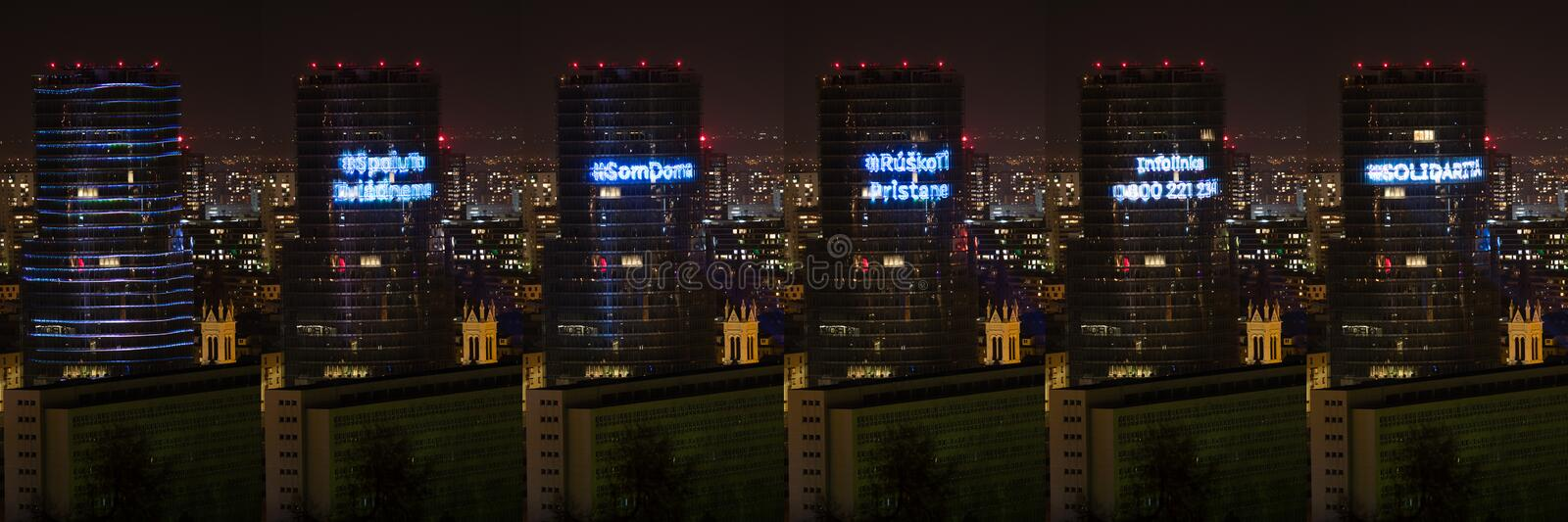 Collage of light hashtags projected to facade of Slovakia central bank's building royalty free stock photo