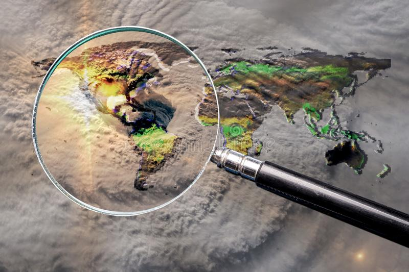 Collage with magnifying glass searching at the earth map with huge hurricane. And hurricane eye above the America. Elements of this image furnished by NASA stock images