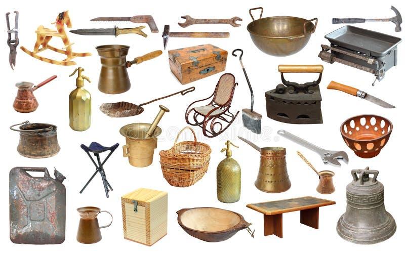 Collage met zeer oude voorwerpen over wit stock afbeelding