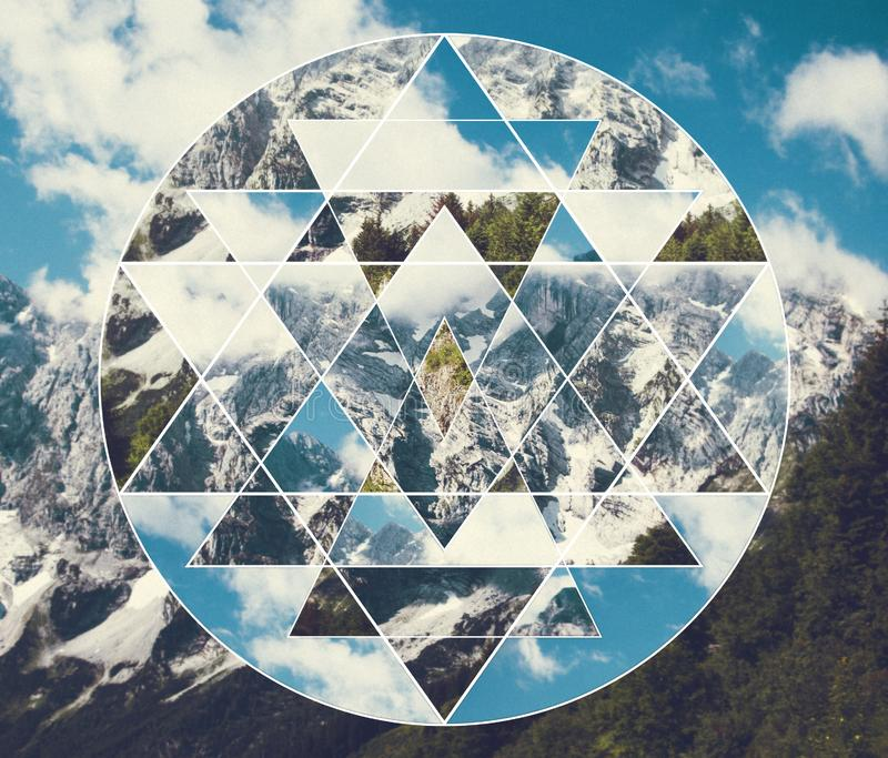 Collage with the mountains landscape and the sacred geometry symbol shri yantra. Abstract meditative collage with the image of the mountain landscape and the royalty free stock photo