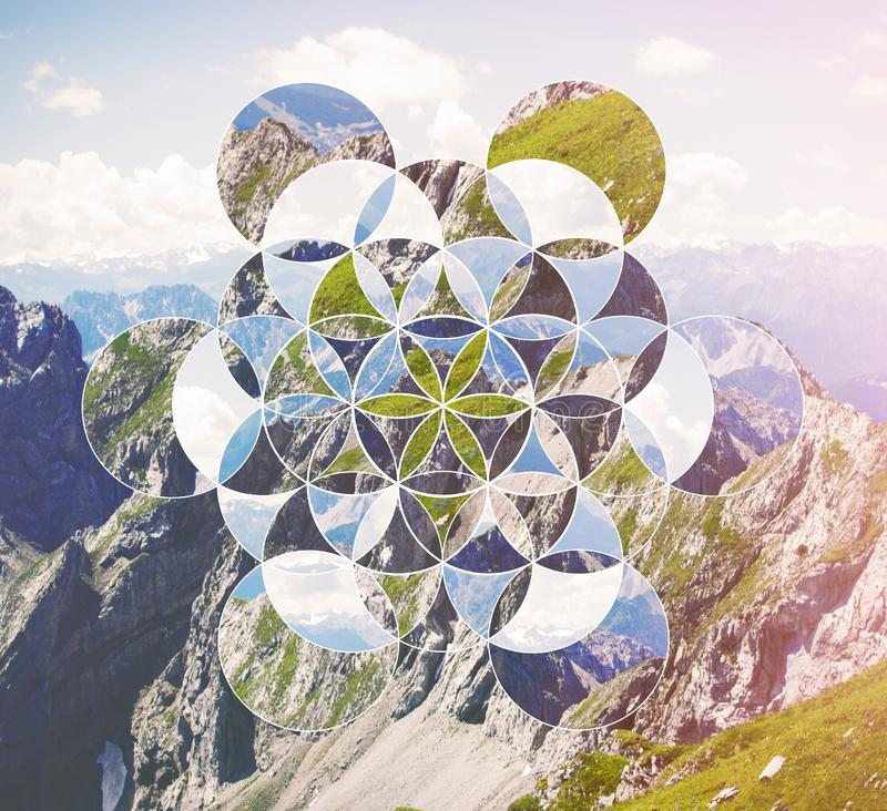 Collage with the mountains and the symbol flower of life stock images