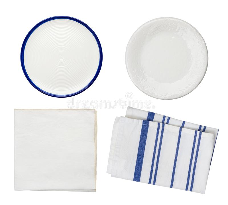 Collage of plates and folded kitchen towels isolated on white stock photo