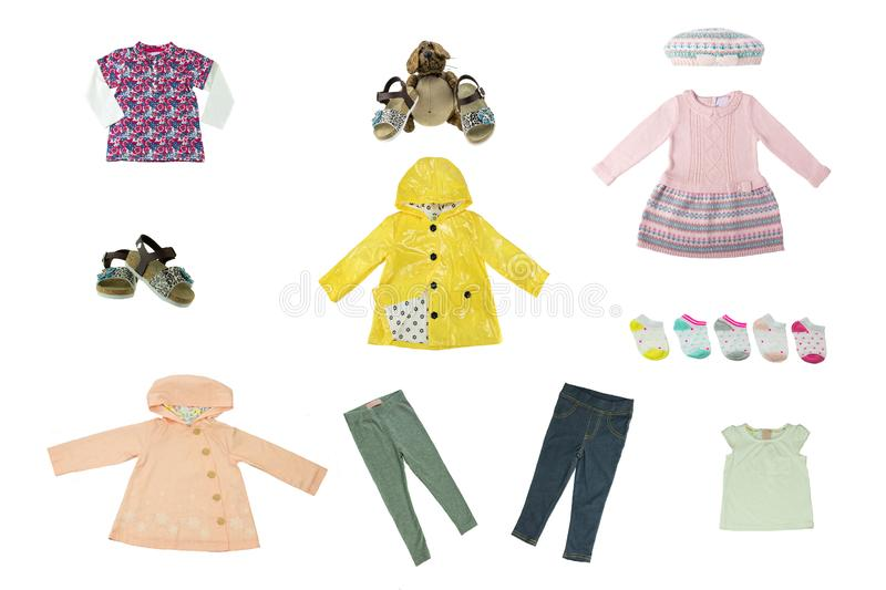 Collage set of children clothes. Concept spring autumn and summer clothes. Isolated on white. Close up. stock photography