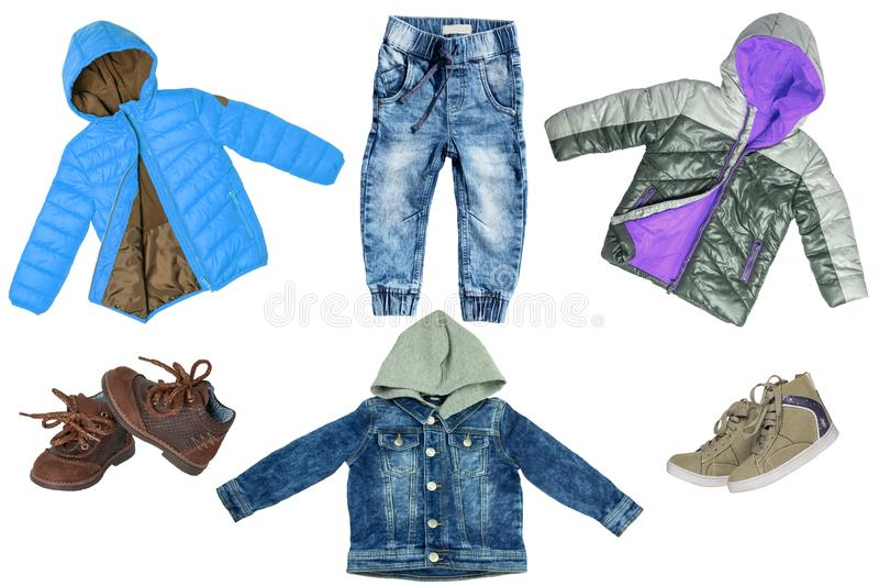 Collage set of children clothes. Denim jeans or pants, jeans jacket, two pair shoes ,and two rain jackets for child boy isolated. On a white background. Concept royalty free stock photos