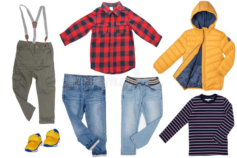 Collage set of children clothes. Denim jeans or pants, a pair shoes , a rain jacket, shirt and a sweater for child boy isolated on. A white background. Concept stock photos