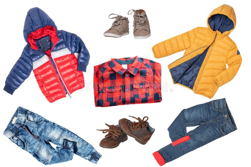 Collage set of children clothes. Denim jeans or pants, shoes, a shirt and rain jackets for child boy isolated on a white. Background. Concept spring autumn and royalty free stock photography