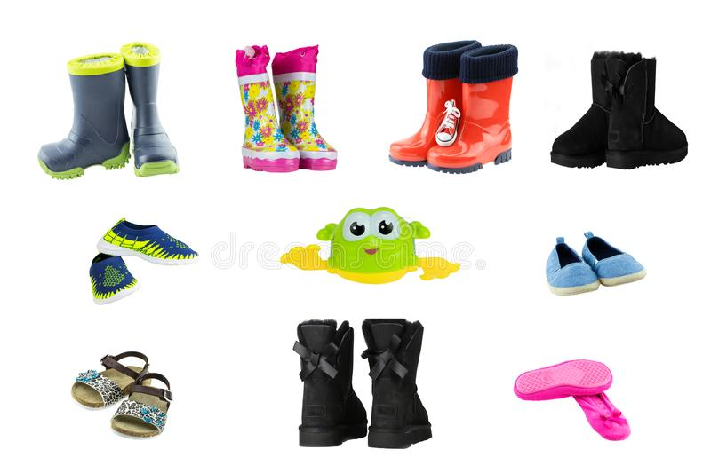 Collage set of children shoes and boots. Collection of seasonable children shoes and rubber boots isolated on a white background. royalty free stock image